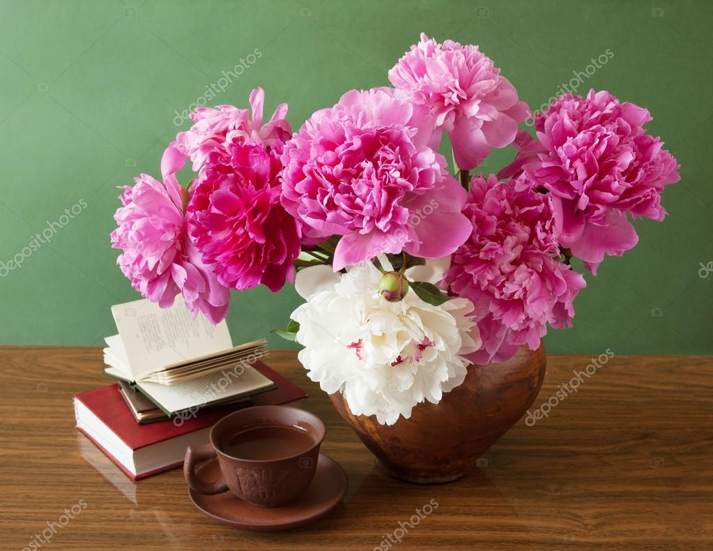 Still life with peony flowers and books on artistic background