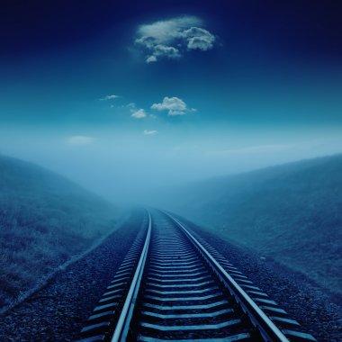 railroad in night under blue moonlight.