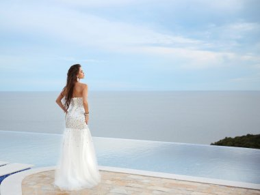 Beautiful bride girl in beaded wedding dress. Summer holiday fas