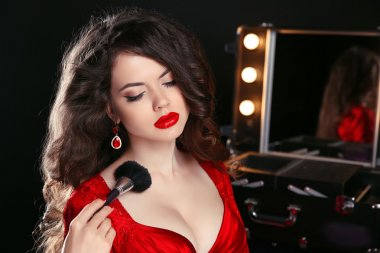 make up rouge. Red lips. Fashion Beautiful woman with long wavy