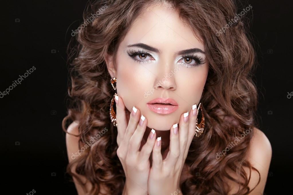 Beautiful fashion woman with makeup, long wavy hair and manicure