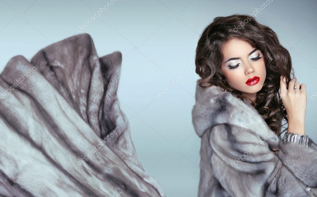 Beauty Fashion Woman in Blue Mink Fur Coat. Beautiful Luxury Win