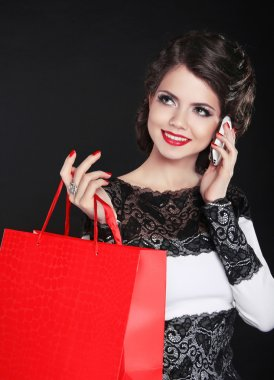Attractive smiling girl with Shopping Bags. Sales. Laughing woma