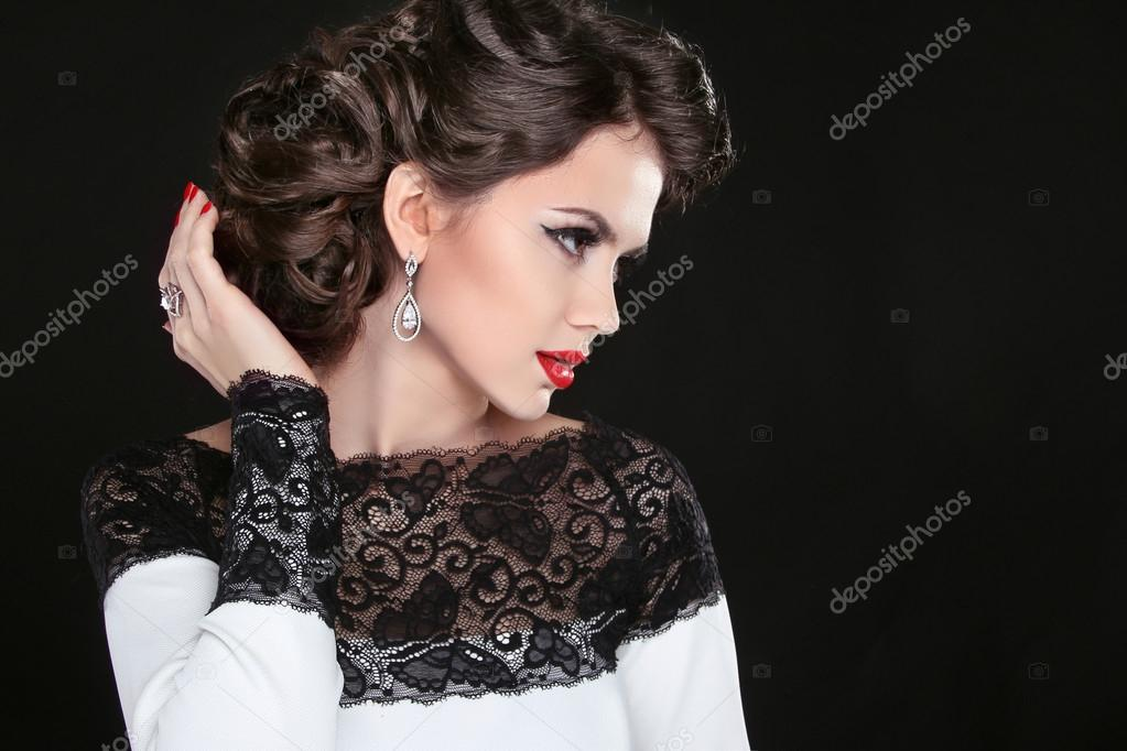 Retro hairstyle. Beautiful Brunette Woman. Fashion portrait with