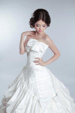 Bridal makeup, hairstyle. Beautiful charming bride in wedding lu
