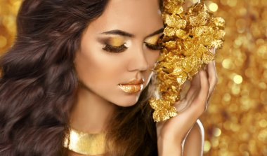 Fashion Beauty Girl Portrait. Eyes makeup. Golden jewelry. Attra