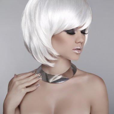 Beauty Blond Girl Portrait with Smoky eyes, long eyelashes. Make