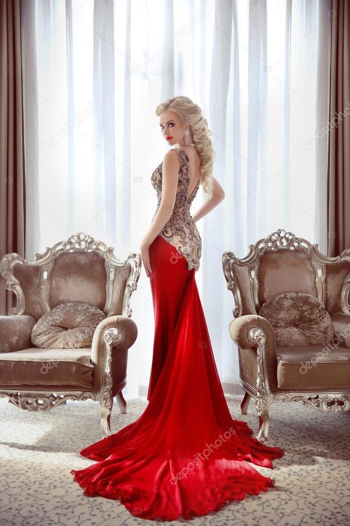 Elegant lady. Beautiful blond woman model in fashion dress with