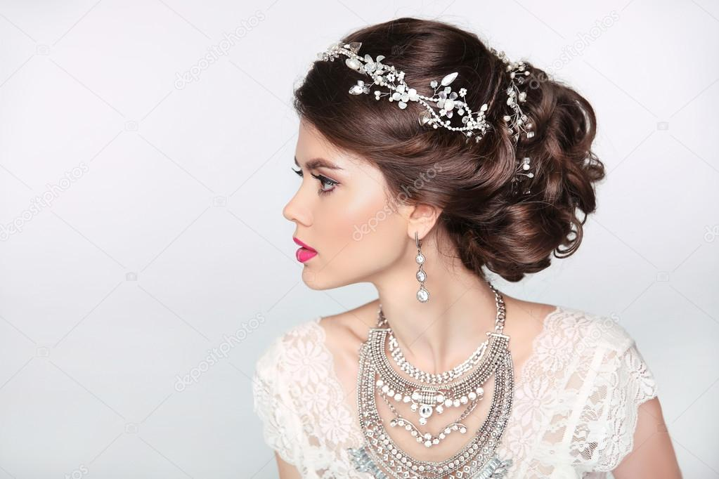 Beautiful Elegant Girl Model With Jewelry Makeup And Retro Hair