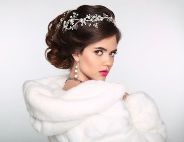 Beauty Fashion Model Girl in white Mink Fur Coat. Wedding hairst