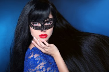 Beautiful Healthy Hair. Beauty woman in mask with luxurious long