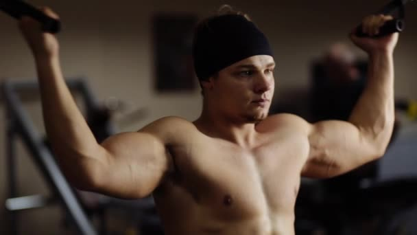 Biceps workout in machine. Slow motion