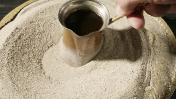 Man brewing coffee in jezve, closeup