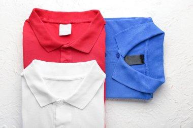 New male shirts on light background