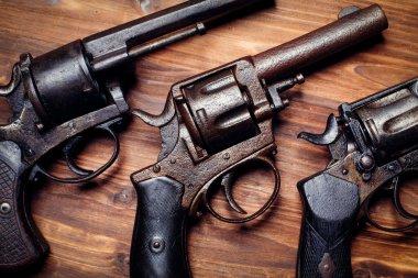 Vintage pistols on wooden background