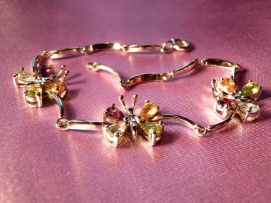 Silver bracelet with multi-colored cubic zirconias, macro. Jewelry macro.