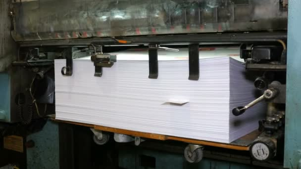 Printed paper is laid in pile