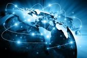 Fotografie World map on a technological background, glowing lines symbols of the Internet, radio, television, mobile and satellite communications. Elements of this image furnished by NASA
