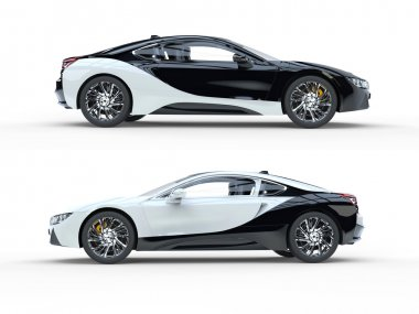 Black and white modern sports cars - side view