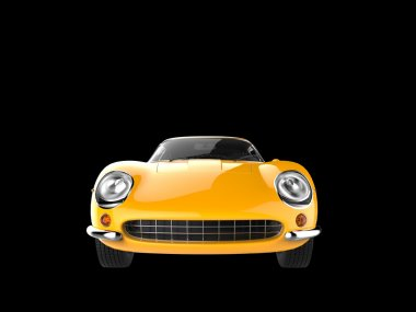 Vintage yellow sports car - front view closeup shot