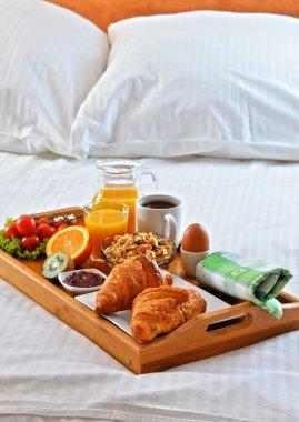 Breakfast tray in bed in hotel room. stock vector