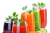 Fotografie Glasses with fresh vegetable juices isolated on white