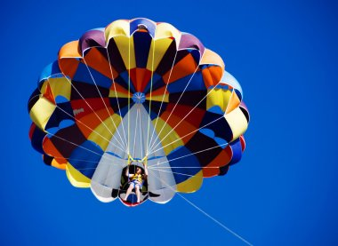 Parasailing over the blue sky