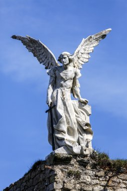 Sculpture of a Guardian angel with a sword in the cemetery of Comillas