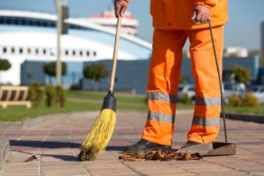 Street Sweeper cleaning city sidewalk