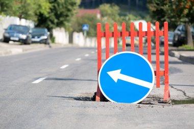 Road sign at city street