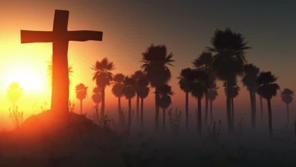 Kříž silueta s palmami a zářící slunce