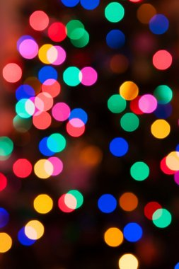 Glowing Christmas lights background in soft focus