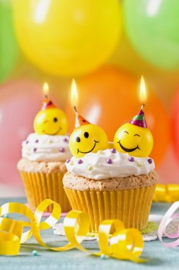 Cupcakes with smiley candles