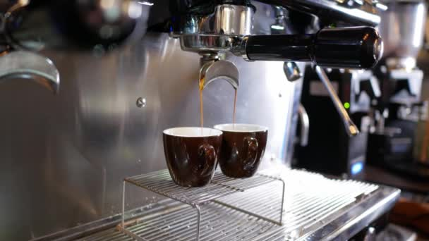 coffee machine pours double cup of espresso
