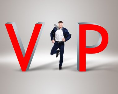 Young businessman in the middle of word 'vip'
