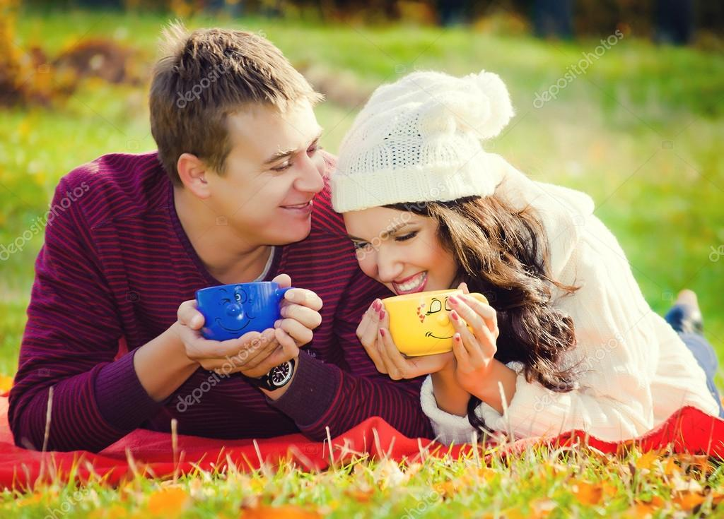young couple relaxing in nature and drinking tea