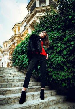 Young fashion girl posing outdoors