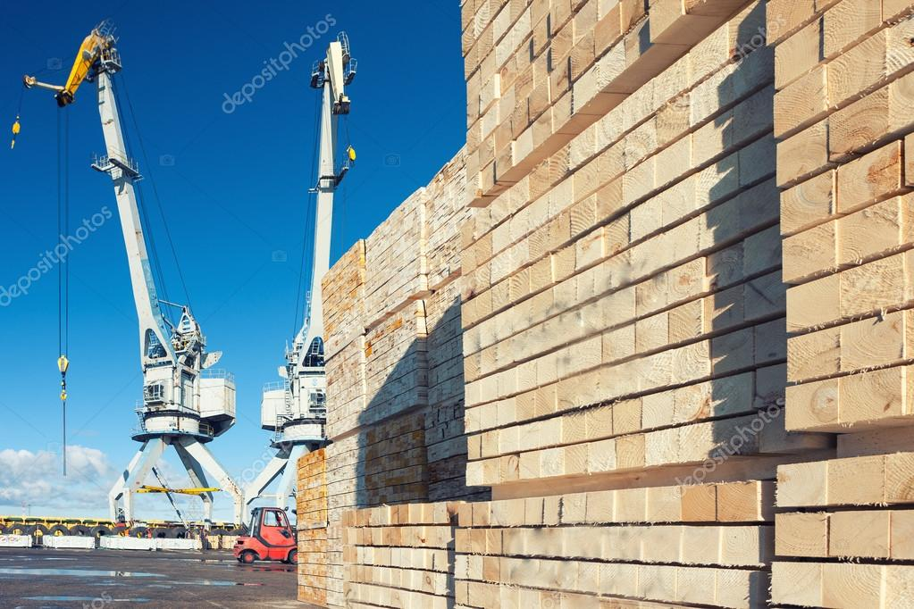 Wooden blocks on the loading at the port with cranes