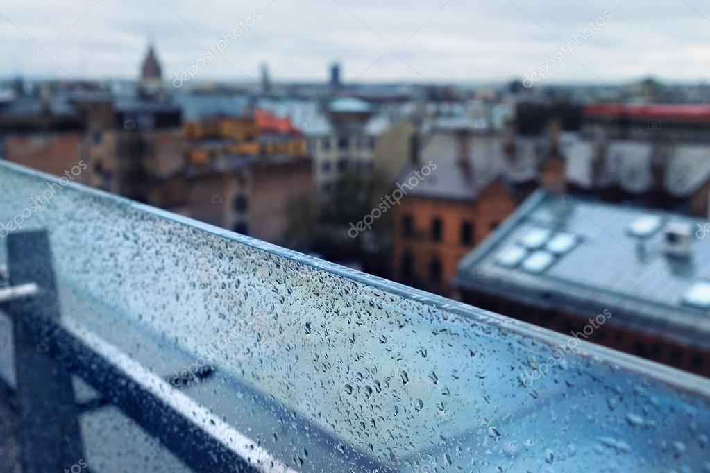 The roofs of the city from the top of a glass partition in the r