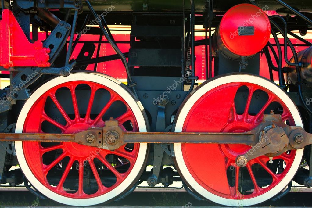 Red locomotive wheel with black mechanisms — Stock Photo