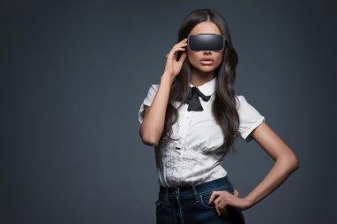 Beautiful woman wearing virtual reality goggle