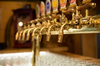 Different beer taps in the bar