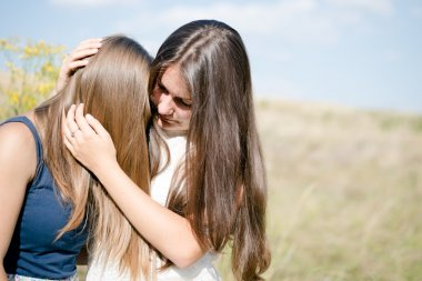 Two teenage girls friends having difficult times friendship concept
