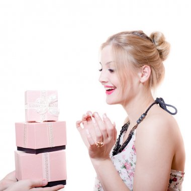 Picture of receiving gifts or presents surprised attractive blond young woman elegant female having fun happy smiling isolated on white background portrait