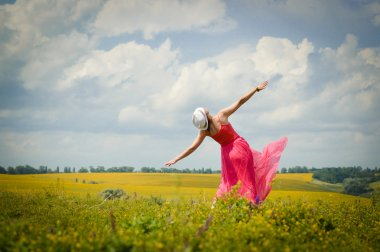 Woman dancing on summer meadow