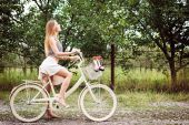 Girl cycling on country road