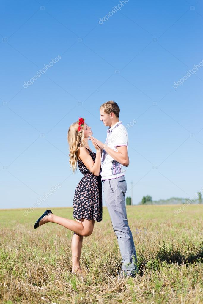 Couple holding hands at blue sky background