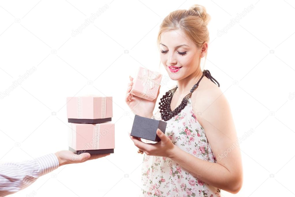 Woman receiving  gifts in pink boxes