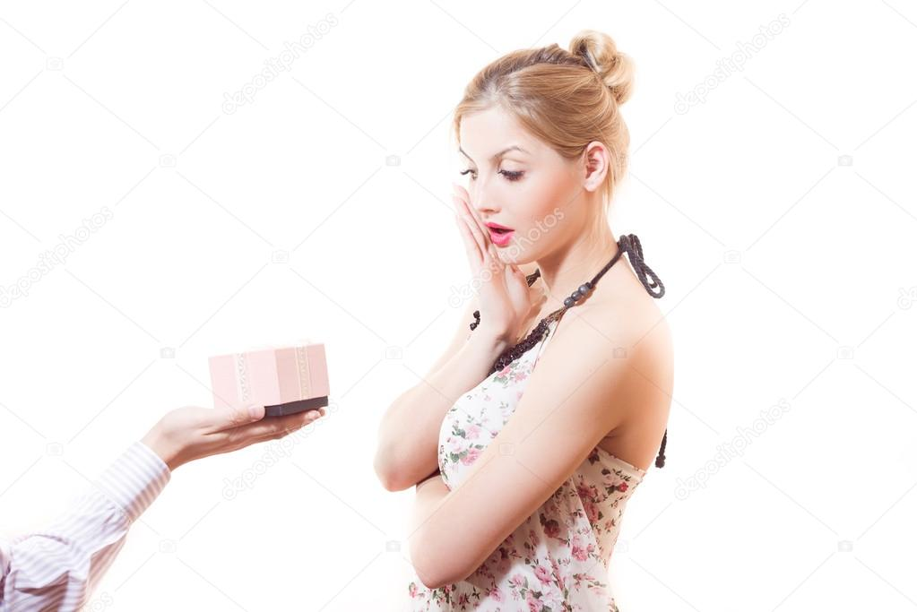 Woman receiving  gift in pink box