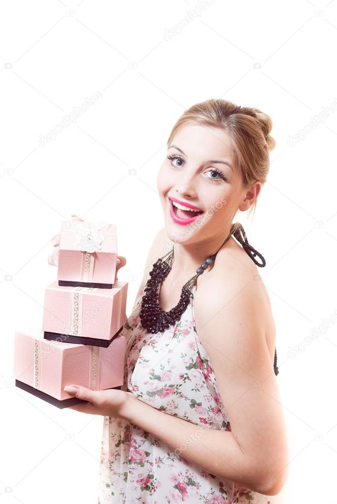 Woman holding  gifts in pink boxes